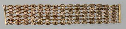 Bracelet six rangs articulés en or jaune...