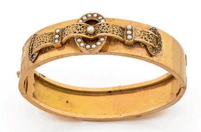 Bracelet rigide ouvrant en or jaune 750 millièmes,...
