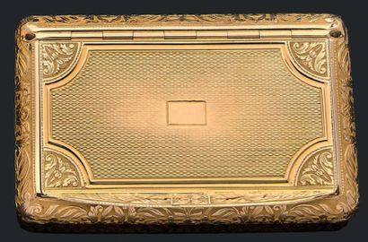 Boîte en or jaune 750 millièmes à décor guilloché...