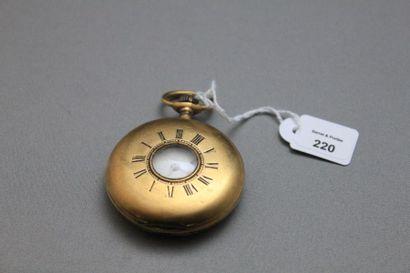 Montre de dame demi-savonnette en or jaune 750 millièmes, le fond monogrammé à remontoir...