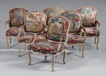 Suite de six fauteuils à dossier plat à la...