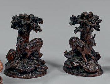 Paire de flambeaux en Bois sculpté de chamois,...