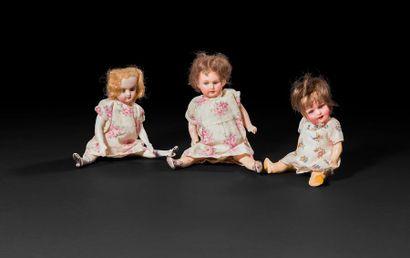 Lot de 3 petites poupées à têtes en porcelaine...