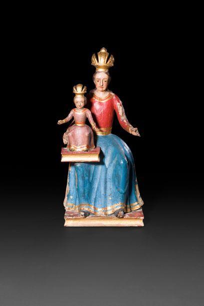 Vierge à l'Enfant en bois sculpté, polychromé...