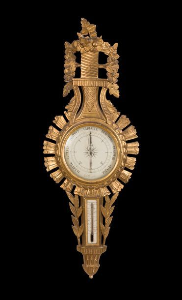 Baromètre formant thermomètre en bois doré,...