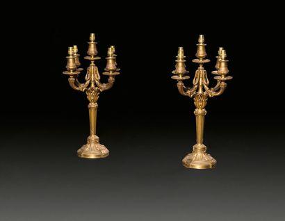 Paire de candélabres en bronze doré à quatre...