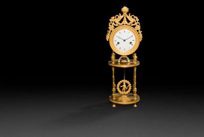 Pendule en bronze doré, le cadran à chiffres...