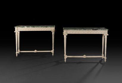 Paire de consoles en bois sculpté et peint,...