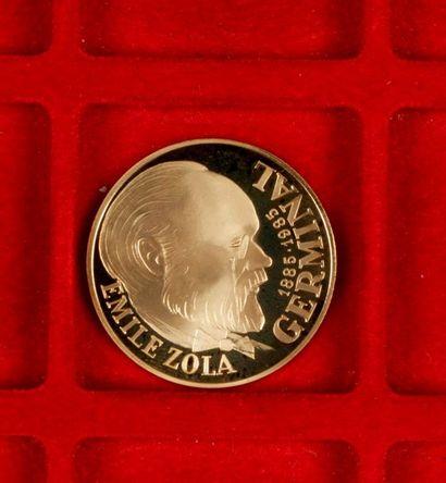 """Pièce de 100 Francs en or. """"Germinal """". 1985 Poids : 17 g Ecrin et certificat Monnaie..."""