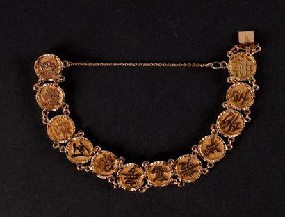 Bracelet gourmette en or jaune à décor d'une...