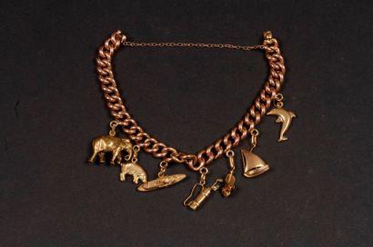 Bracelet en or à pampilles (animaux). Poids...