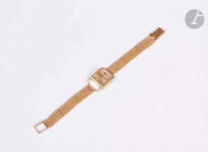 JEAN ÉTÉ. Montre de dame en or jaune 18K (750), cadran rectangulaire, bracelet articulé...
