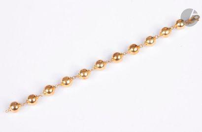 Bracelet en or jaune 18K (750), articulé...