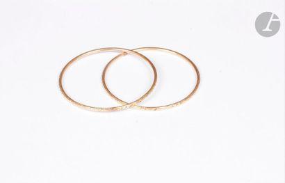 Lot de deux bracelets en or 18K (750) gravé. Poids : 32 g