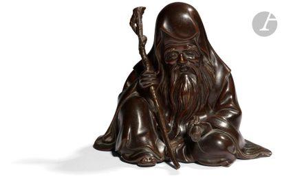 JAPON - XIXe siècle Statuette en bronze à patine brune de l'une des sept divinités...