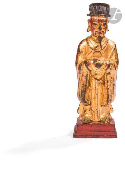 CHINE - Époque MING (1368 - 1644) Statuette de dignitaire en bronze laqué or, debout...