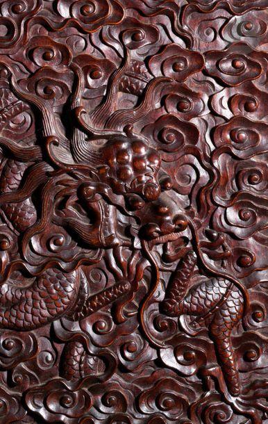 CHINE - XIXe siècle Paire d'armoires en bois exotique ouvrant par deux portes imbriquées...