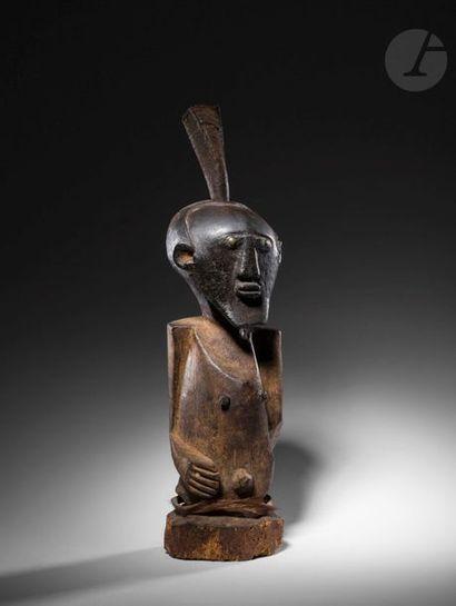 Une ancienne statuette nkishi d'un type rare,...