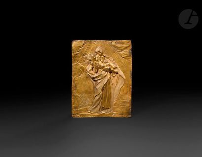 Plaque en bronze doré représentant la Vierge...