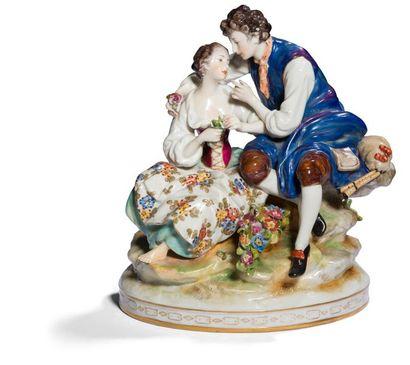 Groupe à deux figures en porcelaine représentant...