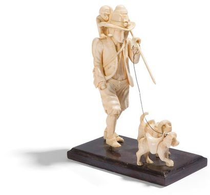 Le montreur d'animaux en ivoire sculpté en...