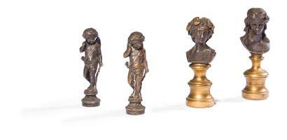 Quatre manches de sceaux à cacheter en bronze...