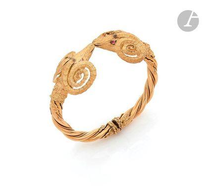 Bracelet ouvrant en or 18K (750) torsadé,...
