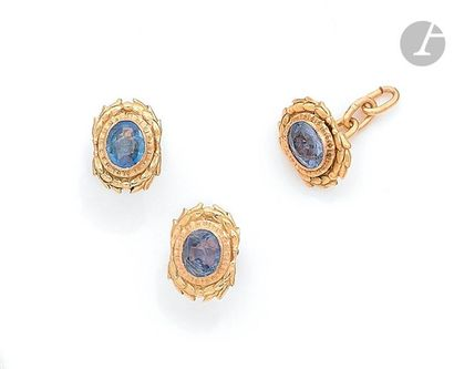 Pair of 18K (750) gold earrings, each adorned with an oval-shaped sapphire set in...
