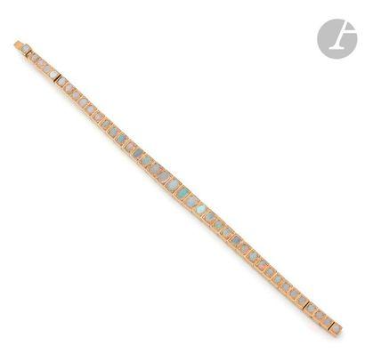 Bracelet articulé en or 18K (750) serti d'opales...