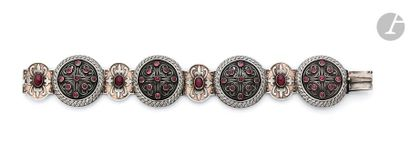Silver bracelet, articulated with circular motifs set with cabochon garnets in chiseled...