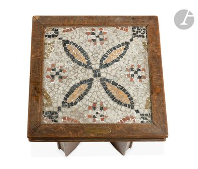 Fragment of a mosaic with stylized four-lobed floral decorationBeige and pink limestone...