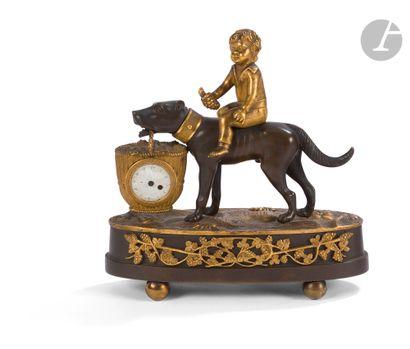 Pendule en bronze patiné et bronze doré le...