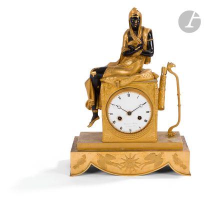 Pendule en bronze doré et bronze patiné (patine...