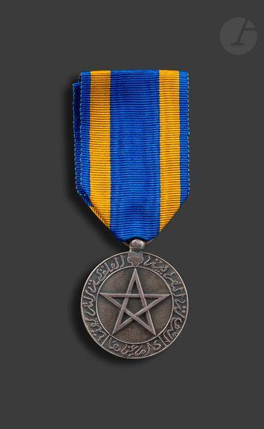 MOROCCO Cherifian Civil Merit Medal, created in 1924. In silver. Hallmark on the...