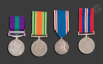 GEORGES VI Quatre médailles : - THE DEFENCE...
