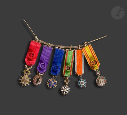 Chainette de gala en vermeil de cinq miniatures...
