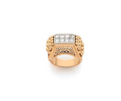 Bague en or 18K (750), ornée de 8 diamants...
