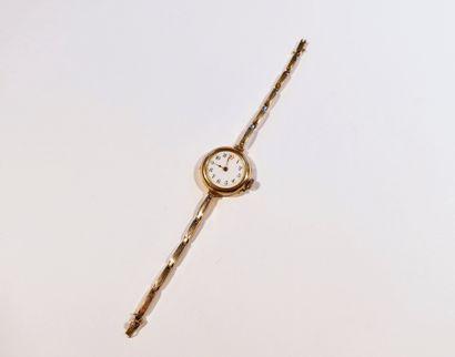 Montre bracelet pour femme en or 18K (750), cadran en émail blanc, index chiffres...