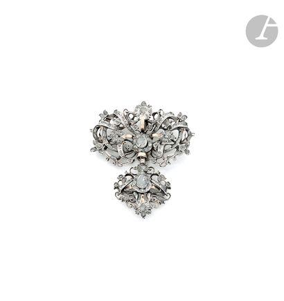 A silver and gilt silver bipartite pendant,...