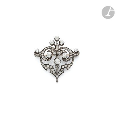 Silver and 18K (750 ‰) gold fleuron brooch,...