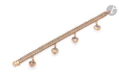 18K (750 ‰) pink gold bracelet, holding in...