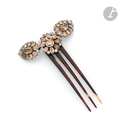 Tortoiseshell comb with a stylized flowery...