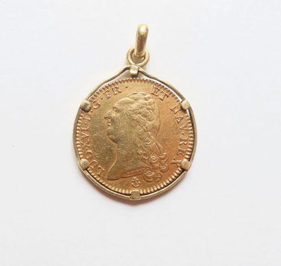 Pendentif en or serti d'une pièce en or (22K)...