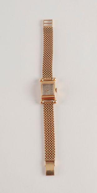 Bracelet montre de dame en or (18K) jaune...