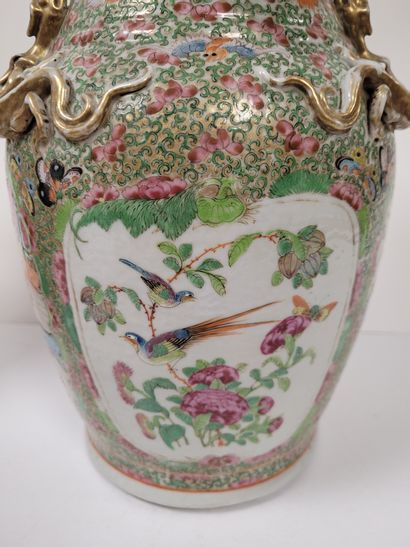 Pair of porcelain baluster vases, Canton, 19th centuryA reserve decoration of characters...