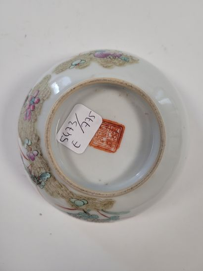 Porcelain bowl, China, 19th centuryA polychrome decoration of butterflies in the...