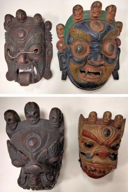 Ensemble de 4 masques rituels, Tibet ou Népal,...