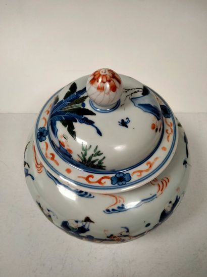 Covered vase with polychrome decoration in the style of the five colors porcelain...