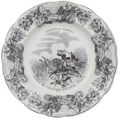 GOEFFROY et C° Gien, sept assiettes à désert de la série «Expédition d'Orient», France,...