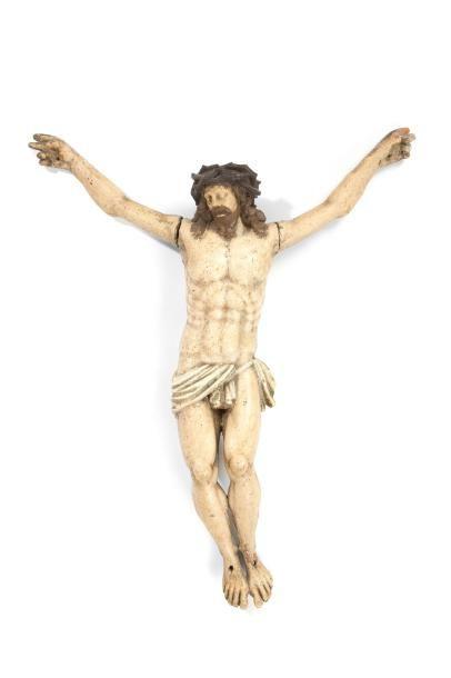 Christ en bois polychrome. Tête ceinte d'une...